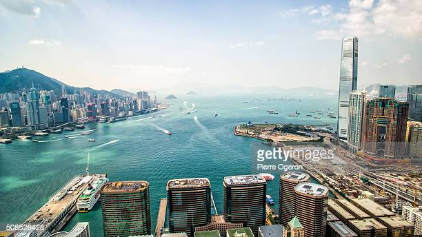 aerial victoria harbor - victoria harbour hong kong stock pictures, royalty-free photos & images