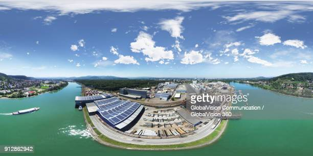 360° aerial view above basel's port and rhine river - basel port stock photos and pictures