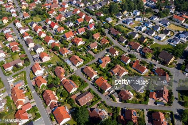 aerial view above suburb houses - real estate stock pictures, royalty-free photos & images
