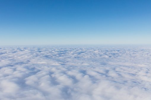 Aerial view, above the clouds. Clear blue sky - gettyimageskorea