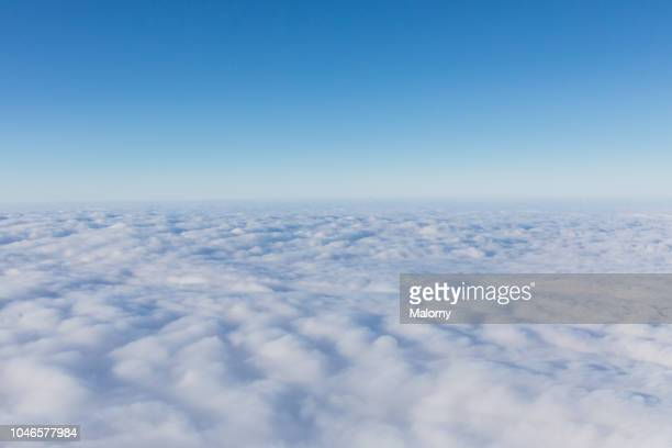 aerial view, above the clouds. clear blue sky - sopra foto e immagini stock