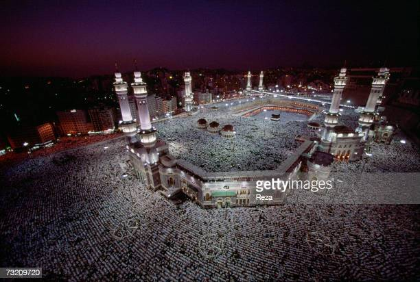 Aerial view as Muslims pray at dusk around the Kaaba Islam's most sacred sanctuary and pilgrimage shrine within the Masjid AlHaram mosque during the...