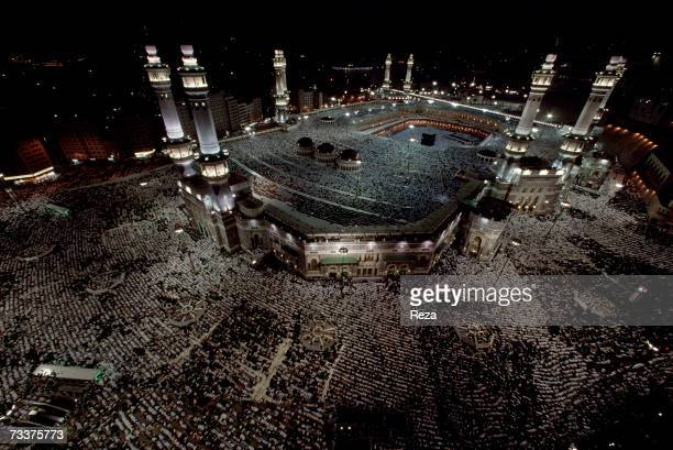 Aerial view as Muslims pray at dusk around the Kaaba Islam's most sacred sanctuary and pilgrimage shrine within the Masjid AlHaram mosque on...