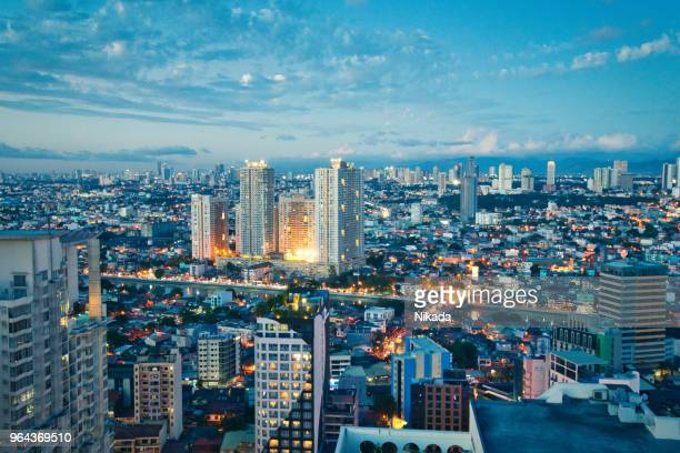 aerial view at twilight of makati business district, manila, philippines - manila philippines stock pictures, royalty-free photos & images