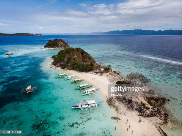 aerial view beautiful beach on a tropical bulog dos island. philippines - southeast stock pictures, royalty-free photos & images