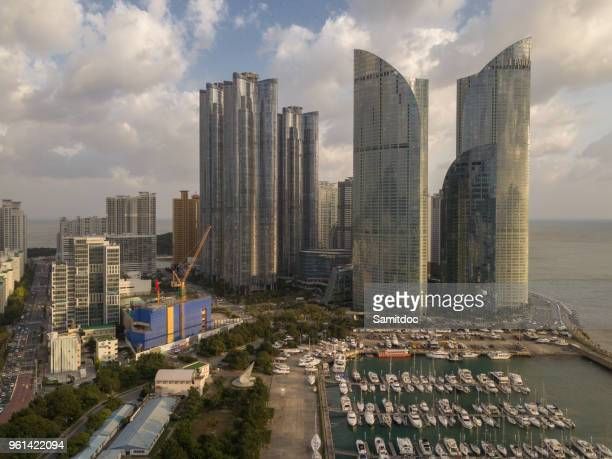 Aerial view Busan marina with yachts, Marina city skyscrapers with clouds sky, Haeundae District, Busan, South Korea.