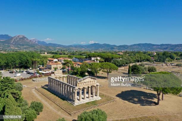 aerial view by drone of ancient greek temples, paestum, italy 10 - ポセイドン ストックフォトと画像