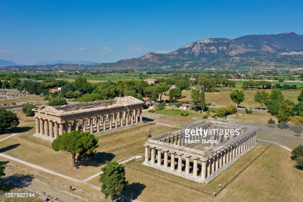 aerial view by drone of ancient greek temples, paestum, italy 2 - ポセイドン ストックフォトと画像