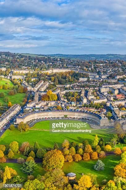 aerial view by drone over the georgian city of bath, royal victoria park and royal cresent, unesco world heritage site, bath, somerset, england, united kingdom, europe - gavin hellier stock pictures, royalty-free photos & images