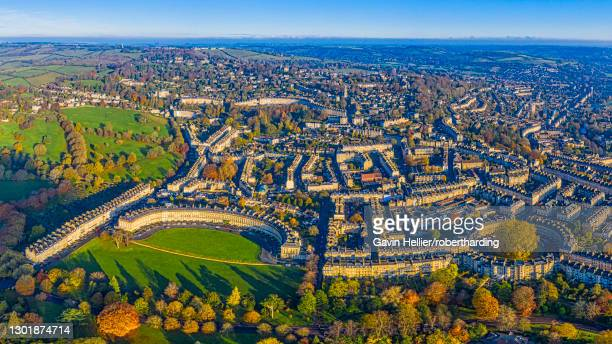 aerial view by drone over the georgian city of bath, royal victoria park and royal cresent, bath, somerset, england, united kingdom, europe - gavin hellier stock pictures, royalty-free photos & images