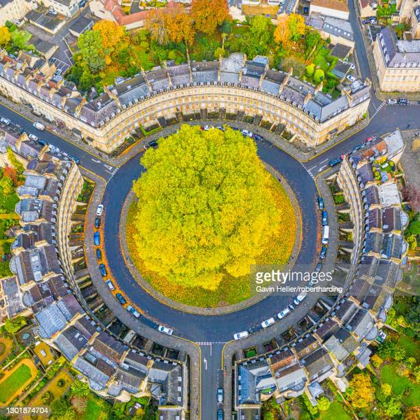 aerial view by drone over the georgian housing of the circus, unesco world heritage site, bath, somerset, england, united kingdom, europe - gavin hellier stock pictures, royalty-free photos & images