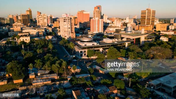 Aerial view captured with a drone of a shantytown in the surroundings of Paraguay's National Congress in Asuncion on April 17 2018 Poverty and...