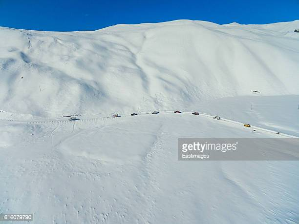 Aerial view car crossed snow covered field,Xinjiang,China.