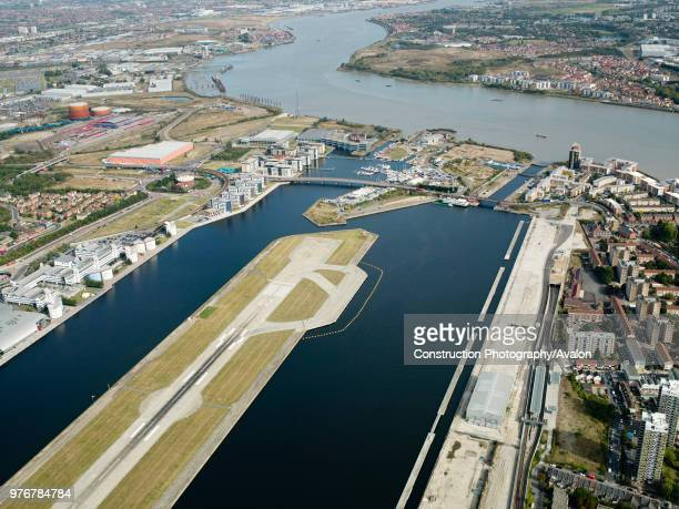 Aerial view City Airport from the east Old Royal Docks University of East London Thames Barrier and Excel Exhibition Centre London UK