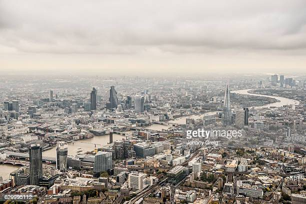 aerial view city of london on a cloudy day - greater london stock pictures, royalty-free photos & images