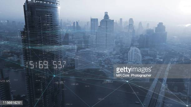 aerial view city with internet connection technology.networking and communication concept.wireless technology and internet of things.smart city concept.big data concept - スマートシティ ストックフォトと画像