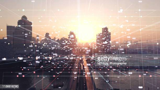 aerial view city with internet connection technology.networking and communication concept.wireless technology and internet of things.smart city concept.big data concept - smart stock pictures, royalty-free photos & images