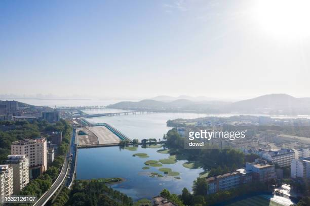 aerial view city with lake - hubei province stock pictures, royalty-free photos & images