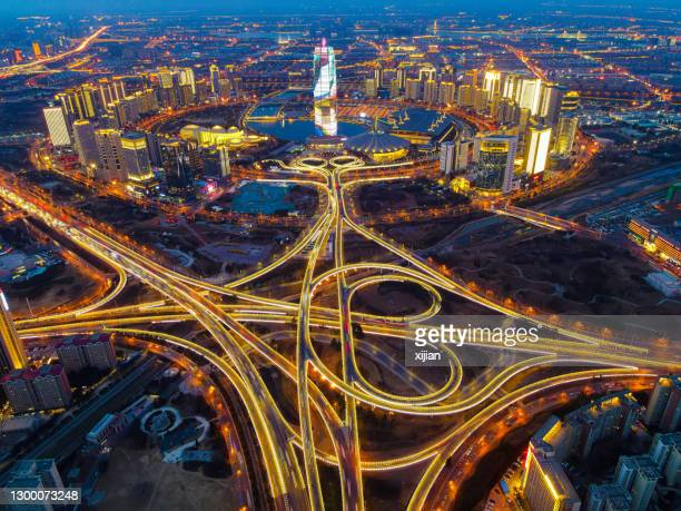 aerial view cityscape of zhengzhou cbd night in china - zhengzhou stock pictures, royalty-free photos & images