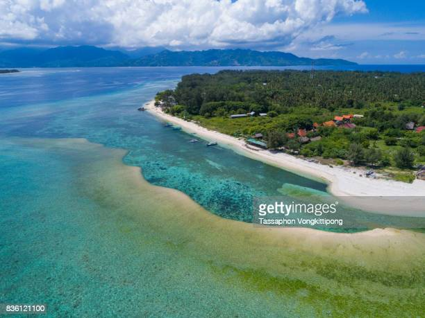 aerial view coastal of gili trawangan island with clear blue sky in lombok, indonesia - gili trawangan stock photos and pictures