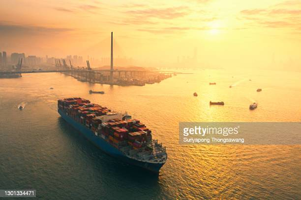 aerial view container cargo ship full carrier container at terminal commercial port transporting shipment container for business logistics, import export, shipping or freight transportation. - business finance and industry bildbanksfoton och bilder