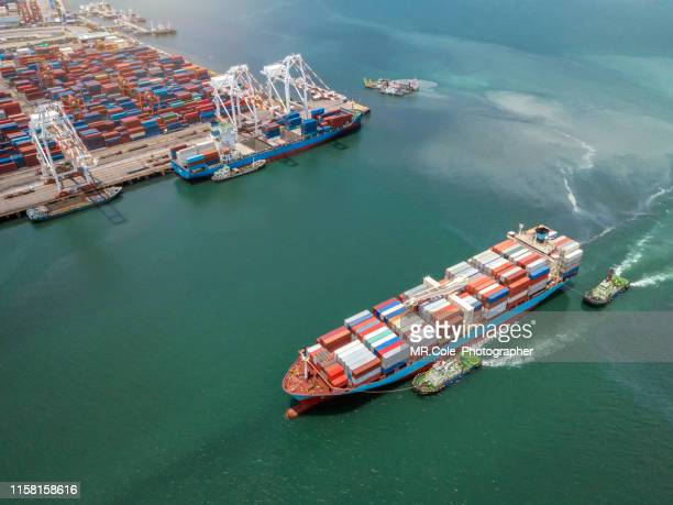 aerial view container cargo ship in the sea carrying to terminal port,industry business logistic and transportation in thailand - commercial dock stock pictures, royalty-free photos & images