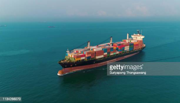 aerial view container crane ship on the sea full load container for logistics, import export, shipping or transportation. - globalization economy stock pictures, royalty-free photos & images
