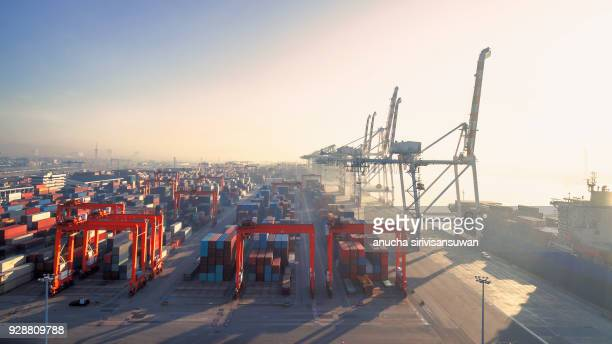 aerial view container in port warehouse waiting for export at sunset, thailand. - haven stockfoto's en -beelden