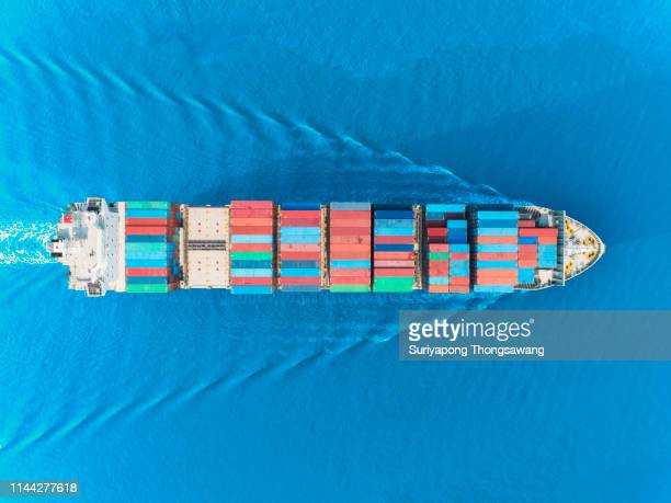 aerial view container ship full load container with beautiful wave pattern for logistics business, import export, shipping or transportation. - industrial sailing craft stock pictures, royalty-free photos & images