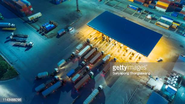 aerial view container truck waiting at check point or terminal for unload container at container warehouse for logistics, import export, shipping or transportation. - caricare attività foto e immagini stock