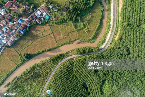 aerial view country village with mountain and mist fog during morning time in asia thailand - land stock pictures, royalty-free photos & images