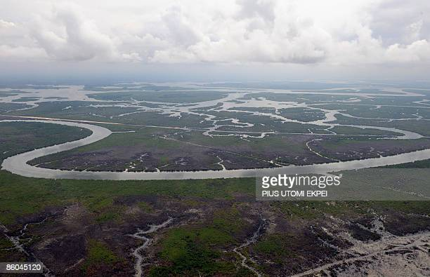 Aerial view dated on April 14 2009 shows the Niger Delta creeks 35 kilometers away from Port Harcourt in Rivers State AFP PHOTO / PIUS UTOMI EKPEI