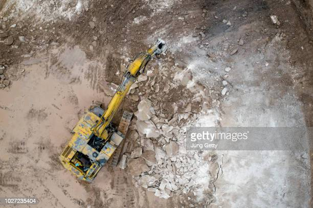 aerial view excavator at construction site - demolishing stock pictures, royalty-free photos & images