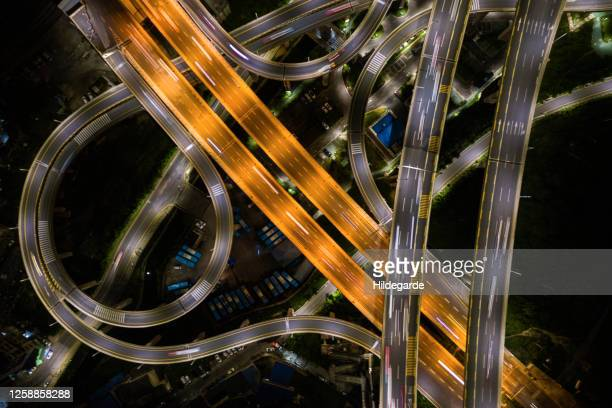 aerial view, expressway road intersection, traffic at night, - drone point of view stock pictures, royalty-free photos & images