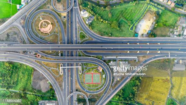 aerial view, expressway road intersection, traffic in bangkok at day, thailand. - bovenkleding stockfoto's en -beelden