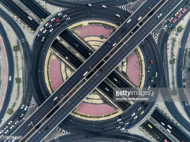 aerial view, expressway road intersection, traffic in bangkok at day, thailand. - top foto e immagini stock
