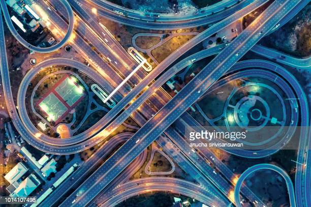 aerial view, expressway road intersection, traffic in bangkok at night, thailand. - crossroad stock pictures, royalty-free photos & images