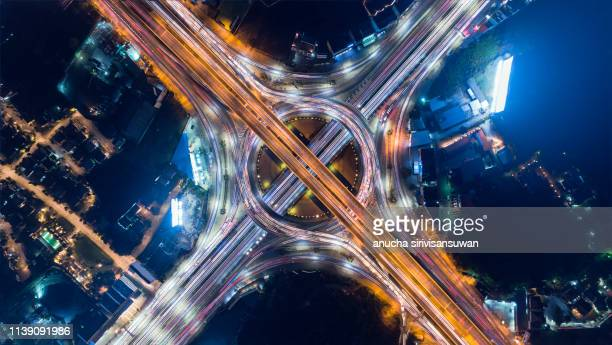 aerial view, expressway road intersection, traffic in bangkok at night, thailand. - svincolo stradale foto e immagini stock