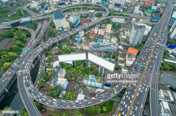 aerial view expressway with traffic jam in bangkok at twilight , traffic circle .