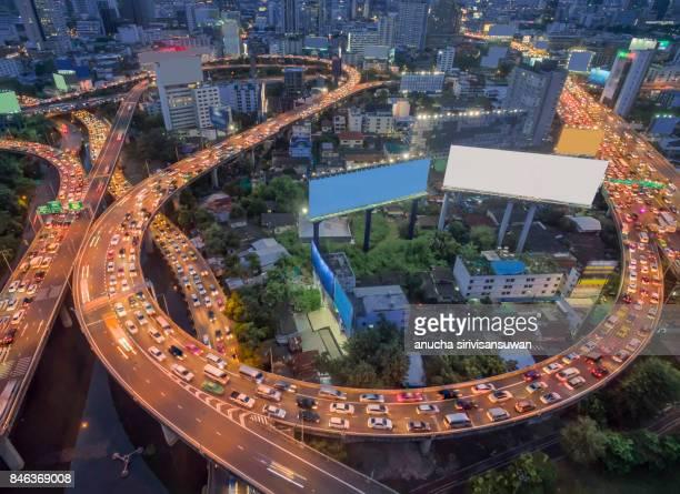 aerial view expressway with traffic jam in bangkok at twilight .