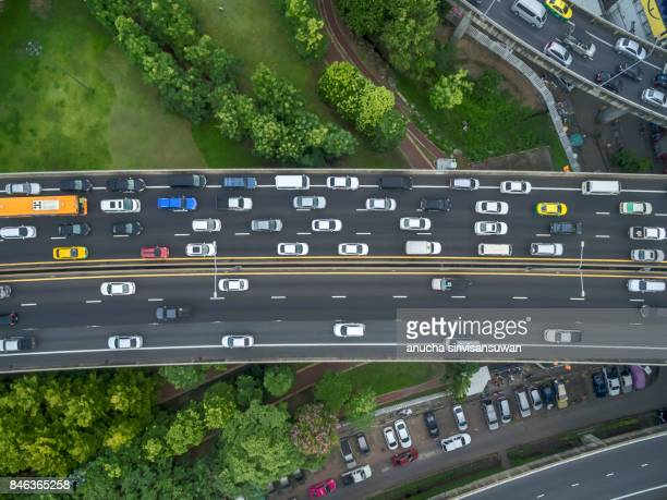 aerial view expressway with traffic jam in bangkok  , top view . - fumes stock photos and pictures