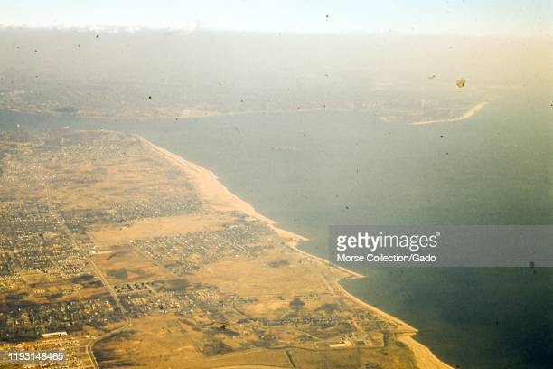 Aerial view facing east of the East Shore region of Staten Island, the water of Lower New York Harbor, and the western tip of Brooklyn, in New York...