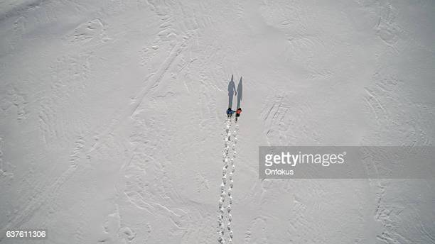 Aerial View Family Snowshoeing Outdoor in winter