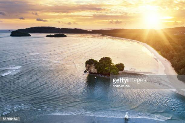 Aerial view flying drone of beauty nature landscape with paradise beach and Ocean in summer day in Krabi. Amazing seascape with small waves.