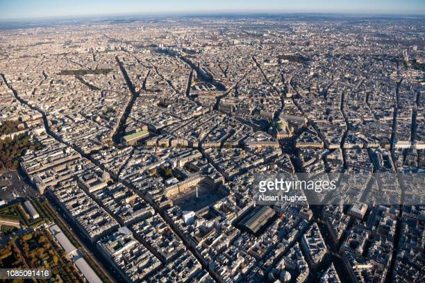 aerial view flying over the center of paris france, daytime - ヴァンドーム広場 ストックフォトと画像