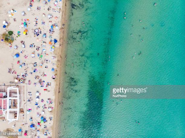 Aerial view from a drone of people at the overcrowded beach of Potamos in Epanomi during a heatwave a beach near Thessaloniki and Halkidiki Beach...