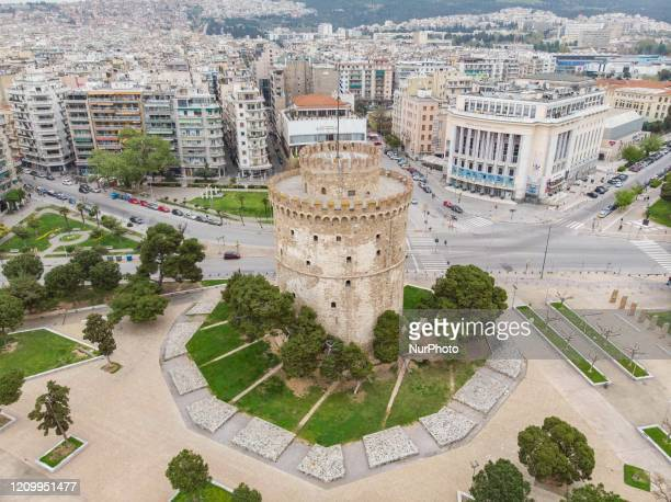 Aerial view from a drone of the White Tower and the empty new promenade waterfront area of Thessaloniki during the traffic ban restrictions and...