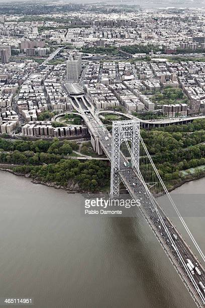 Aerial view from a helicopter of the George Washington Bridge and Haven Avenue in Manhattan passing through the Hudson River New York USA