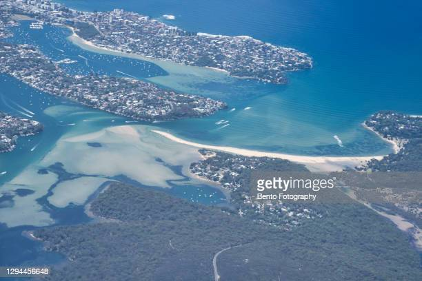 aerial view from airplane window looking at sydney, australia. - 真珠湾 ストックフォトと画像
