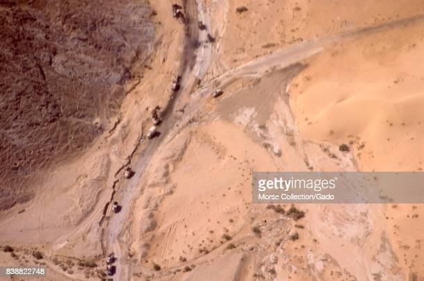Aerial view from an airplane of trucks driving on roadways in the Sinai Desert near El Arish Gaza Israel November 1967